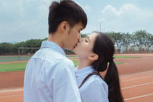 Young Asian Lover Kissing Outdoor