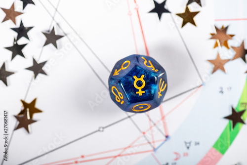 Fotografie, Obraz  Astrology Dice with symbol of the planet Mercury on Natal Chart Background