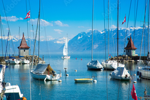 Foto auf Leinwand Blau Picturesque little port and sailing boats on Lake Geneva in Morges