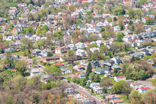 Roanoke, USA Aerial High Angle Bird's Eye View Of Cityscape Residential Neighborhood Suburbs Of City In Virginia During Spring By Mountains