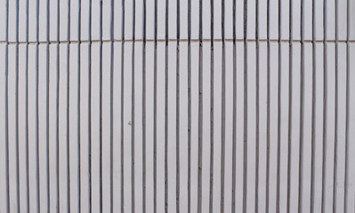 White fence. Concrete wall texture background. Abstract vertical white cement wall texture.