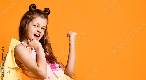 Fotografia  Full length portrait of a cute little teen girl in a stylish skirt and jacket cl