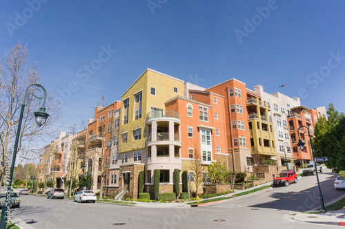 Photo  Residential multifamily building situated on a corner on top of telecommunicatio
