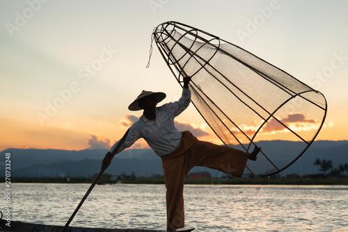 Fotografie, Obraz  Silhouettes fisherman fishing at lake