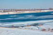 winter landscape , river with frozen shore