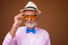 Senior Handsome Tourist Man Wearing Stylish Clothes Against Brow