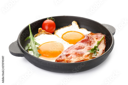Frying pan with eggs and bacon on white background Canvas Print