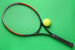 canvas print picture - Tennis racket and ball on color background