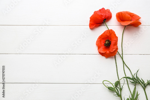 Foto auf Leinwand Mohn Beautiful red poppy flowers on white wooden background