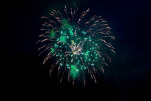 Fireworks In The Night Sky. Green And Yellow Fireworks Background