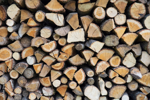 Printed kitchen splashbacks Firewood texture Background of stacked logs stored for fire making