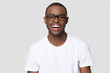 canvas print picture - Headshot portrait african man in glasses laughing looking at camera