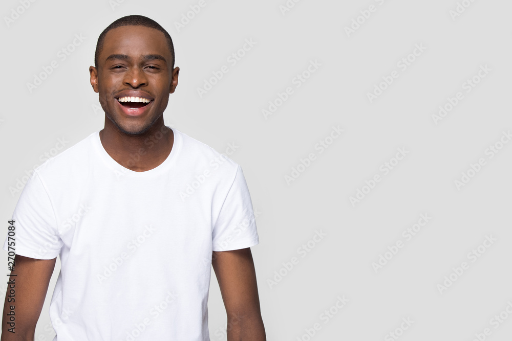 Fototapety, obrazy: African man laughing looking at camera isolated on grey blank