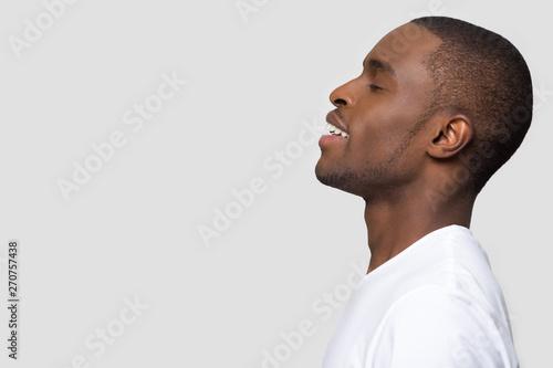 Fotografie, Obraz  Side profile african man face closed eyes enjoy fresh air