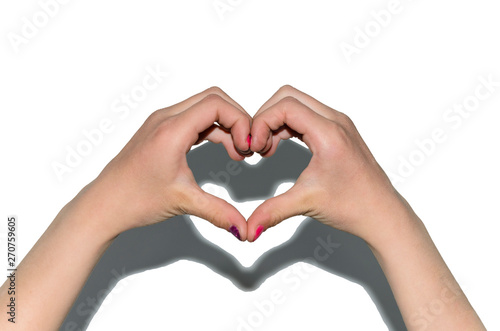 hands folded in the shape of a heart against a white wall, isolate hearts, children's hands, love child, shadow on the wall