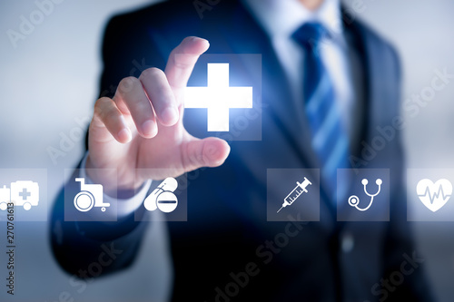 Health insurance concept, Businessman holding Healthcare Medical icon