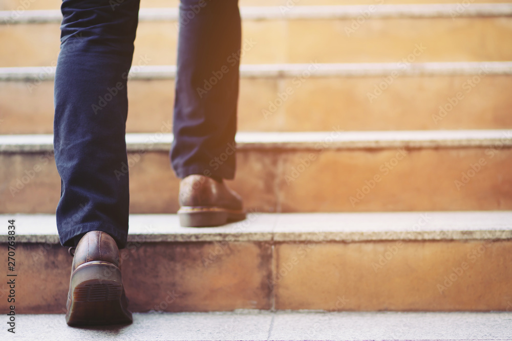 Fototapety, obrazy: modern businessman working  close-up legs walking up the stairs in modern city. in rush hour to work in office a hurry. During the first morning of work. stairway. soft focus.