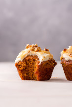 Carrot Cupcakes With Cream Cheese Frosting And Caramel Topping, Close Up