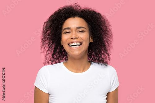 Headshot portrait laughing african woman on pink background Fototapeta