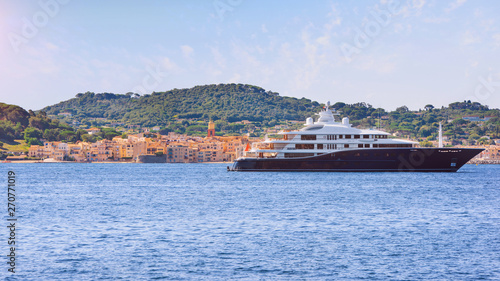 Valokuvatapetti View to saint-tropez city from sea with luxury yacht