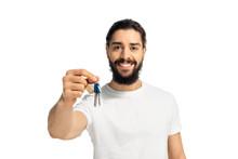 Bearded Latin Man Holding Key And Smiling Isolated On White
