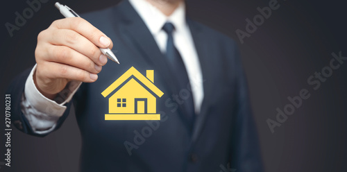 Home insurance, real estate agent in suit