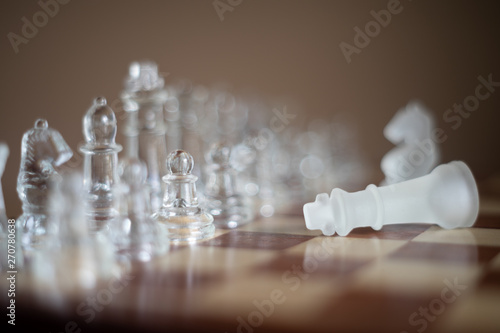 Valokuva  Chess board game made of glass, business competitive concept