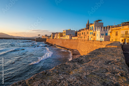 Sunset over the sea front in Alghero (L'Alguer), province of Sassari , Sardinia, Italy Wallpaper Mural