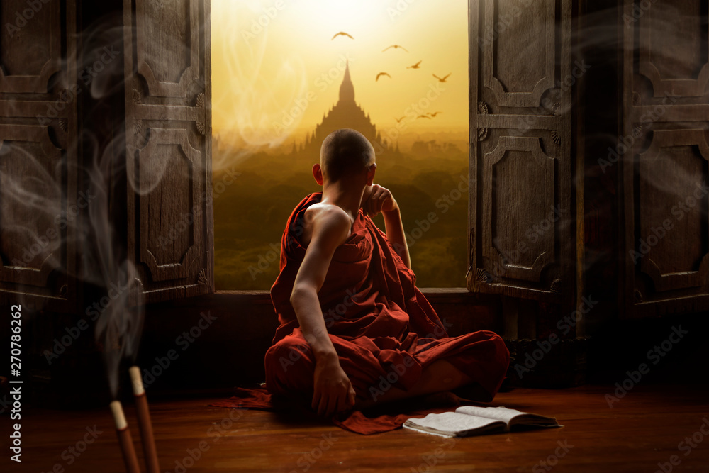 Fototapeta Novice buddhist monk inside a temple in the Bagan Valley