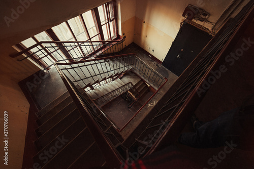 Spiral square staircase in an old house.