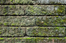 Rough Stone Brick Wall With Lichen And Moss