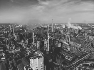 Aerial view of Industrial zone, plants and factories with smoke from chimneys. Air pollution concept