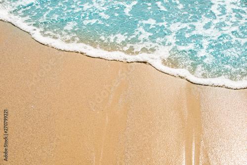 Keuken foto achterwand Strand Soft wave of turquoise sea water on the sandy beach