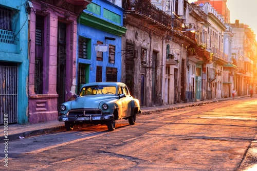 Old blue car parked at the street in Havana Vieja, Cuba Canvas Print