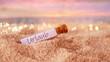 Leinwandbild Motiv Flaschenpost mit Zettel am Strand im Sonnenuntergang: Urlaub