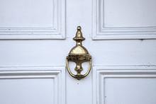 Old Golden Door Knoker On The ...