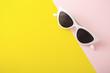 Leinwandbild Motiv Sunglasses on yellow background