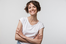 Image Of Cheerful Woman In Basic T-shirt Smiling At Camera While Standing With Arms Crossed