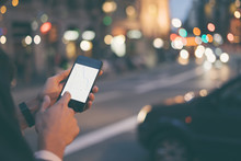 Close Up Of Man's Hands With Smartphone. Tourist Using GPS Map Navigation On Application Screen For Direction To Destination Address In The City. Travel And Technology Concept