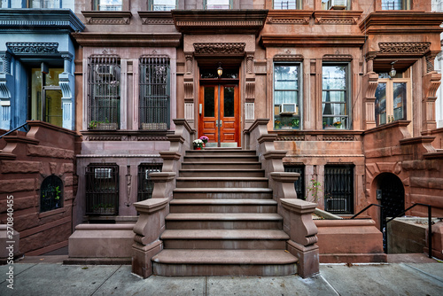 Valokuva a view of a row of historic brownstones in an iconic neighborhood of Manhattan,
