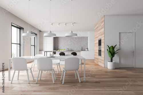 Foto auf Leinwand Texturen White and wooden kitchen with bar and table