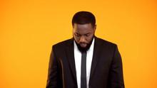 Black Man In Formalwear Lookin...
