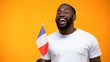 Afro-American man holding French flag on national holiday celebration, close-up