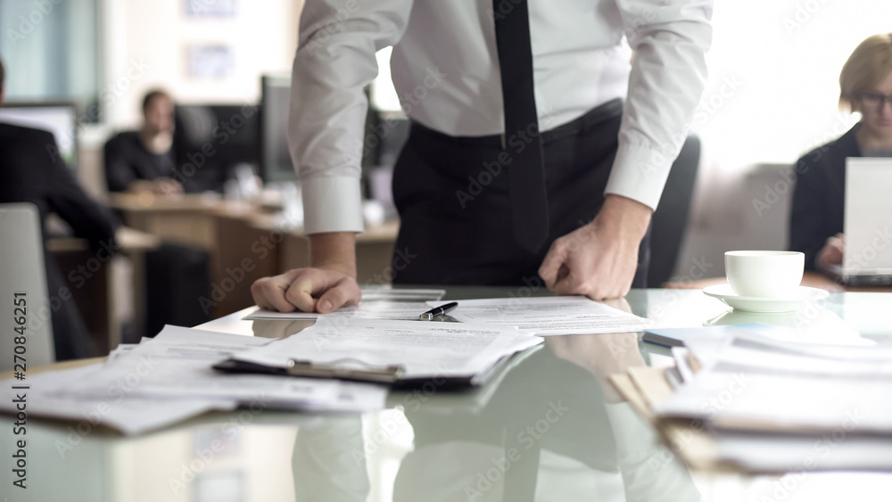 Fototapety, obrazy: Dissatisfied ceo reading contract, leaning on table with anger, error report
