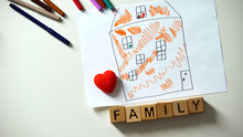 Family Word On Cubes Lying Near Heart Sign And Kids House Drawing, Orphan