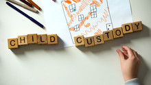 Kid Putting Child Custody Phrase On House Picture, Adoption And Charity Concept