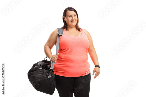 Fotografia  Overweight woman with a sports bag