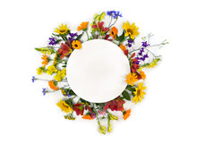Creative Decoration Summer Flowers Sunflowers, Calendula, Linaria, Chamomiles, Blue Cornflowers With White Circle Paper Card Note With Space For Text On White Background. Top View, Flat Lay