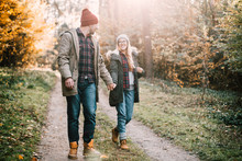 Traveler Couple In Love Enjoying In The Forest. Freedom And Active Lifestyle Concept.