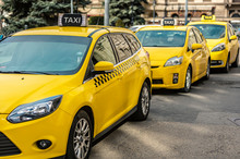 Many Yellow Taxi Cars Standing On The Hungarian Road